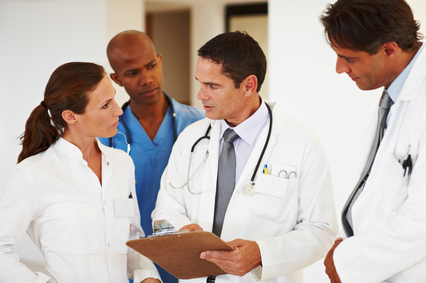 A group of doctors reviewing a case.